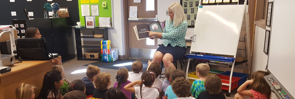 Principal reading to students.
